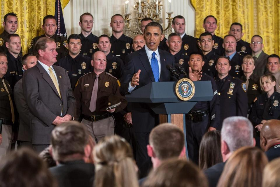 President Obama during a White House ceremony Saturday honoring police.  Stand­­ing at  left, in suit, is Thomas Nee, president of the Boston Police Patrolmen's Association.