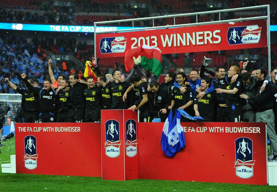 Wigan players celebrate after winning its first FA Cup at Wembley Stadium in London.