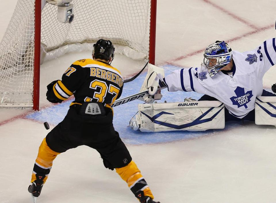 Bruins forward Patrice Bergeron has shooting room but he can't sneak the puck past Maple Leafs goalie James Reimer.
