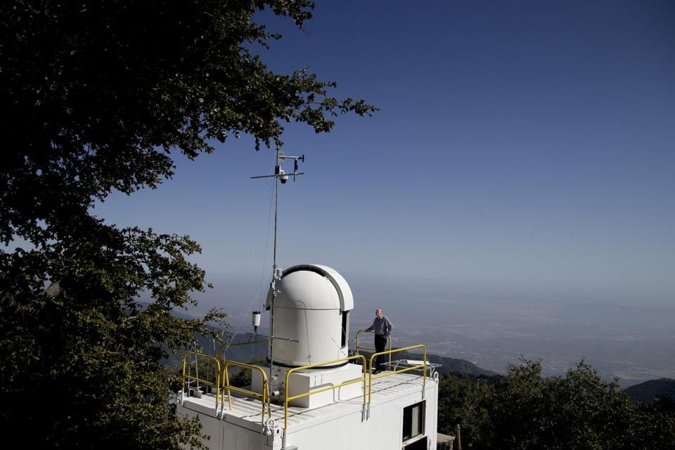 Senior research scientist Stanley Sander stood atop the roof of the California Laboratory for Atmospheric Remote Sensing facility at Mount Wilson, Calif.