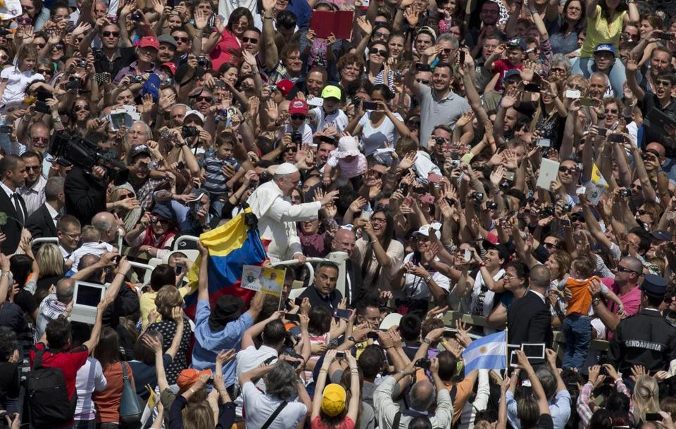 Pope Francis waved to the crowd after a canonization ceremony in St. Peter's Square at the Vatican on Sunday.