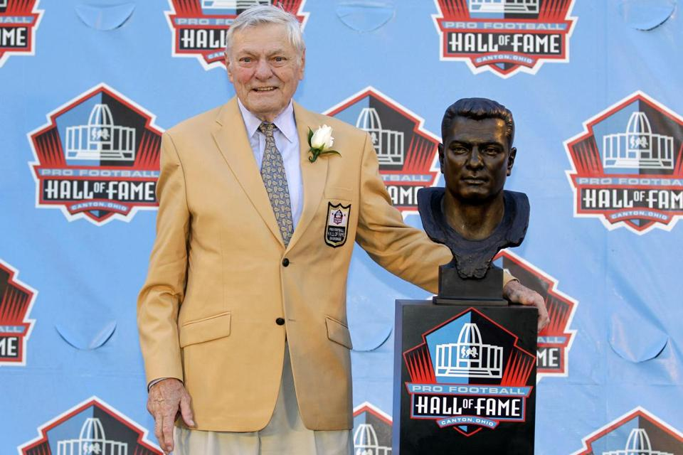 Jack Butler posed with a bust of himself at the Pro Football Hall of Fame last year.