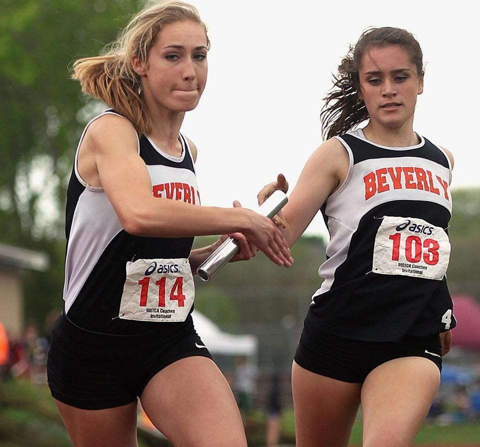 Beverly's Maddie Shropshire takes the baton from Nicole Demars in the 800-meter relay final.