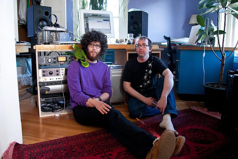 Eli Schwartz (left, who releases music under the name Saul Conrad), Schwartz's 32-year-old parrot, Chico, and engineer Jason Bitner at the home of Mountain of Leopards Records, an independent label founded by Schwartz in Jamaica Plain.
