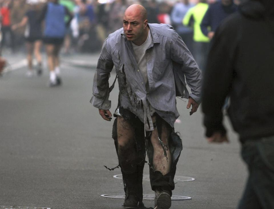 James Costello staggered away after being injured in the Boston Marathon blasts.