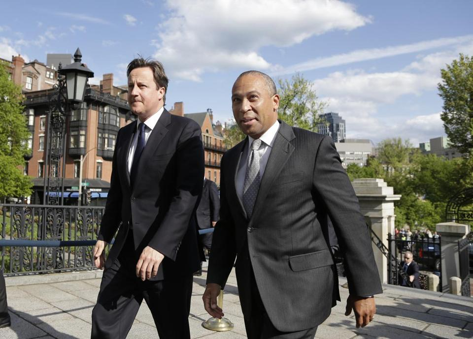 British Prime Minister David Cameron walked with Governor Deval Patrick into the Massachusetts Statehouse.