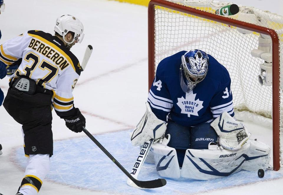 Patrice Bergeron was stuffed by Maple Leafs goalie James Reimer in this shot Sunday.