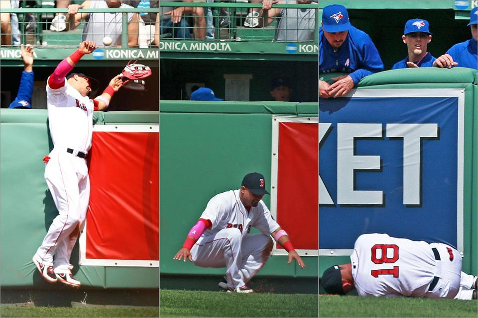 Right fielder Shane Victorino ran hard into the wall in pursuit of a fourth-inning homer. He lost his glove over the fence and was tended to on the field, much to everyone's concern.