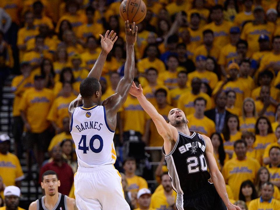Golden State's Harrison Barnes gets his shot off over Manu Ginobili in the fourth quarter of Game 4.