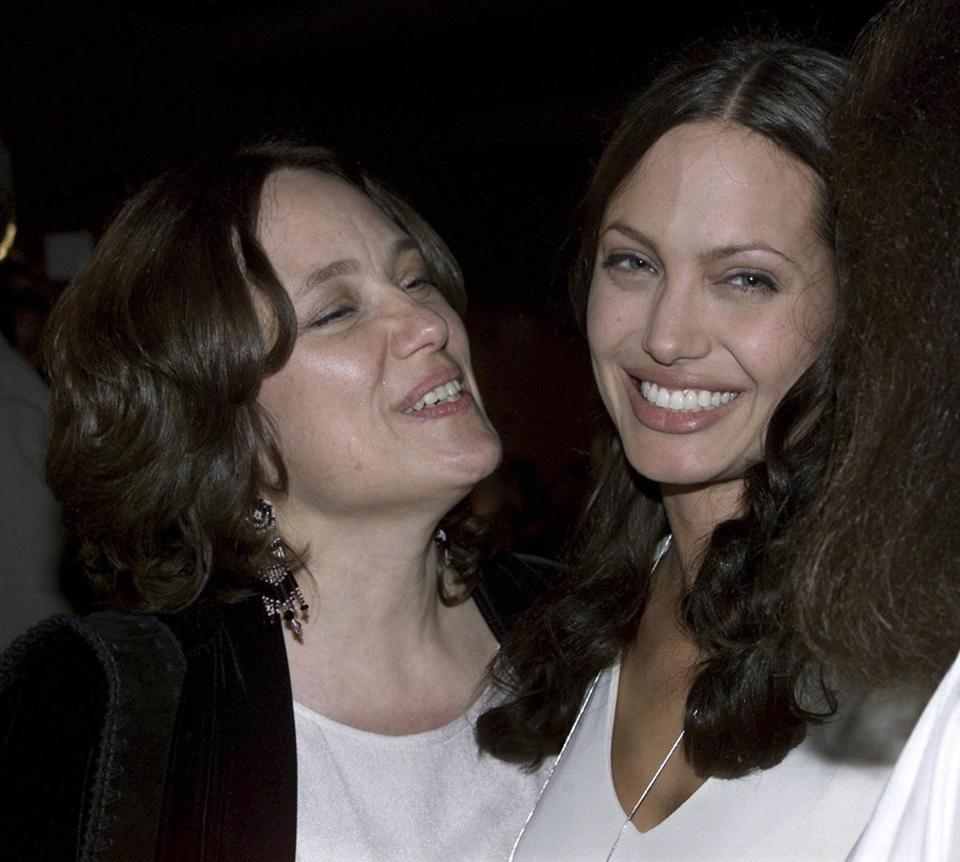 Angelina Jolie, right, is seen with her mother, Marcheline Bertrand, in a July 31, 2001, photo. Bertrand died from cancer at 56.