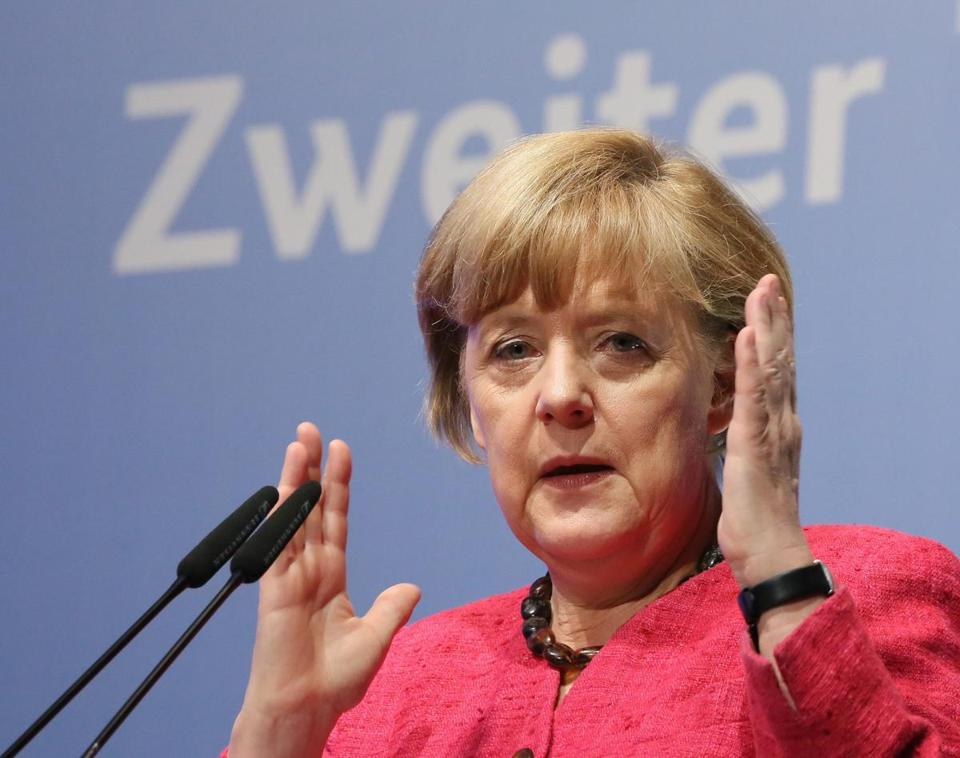 "Angela Merkel urged Germans to face ""truths.''"