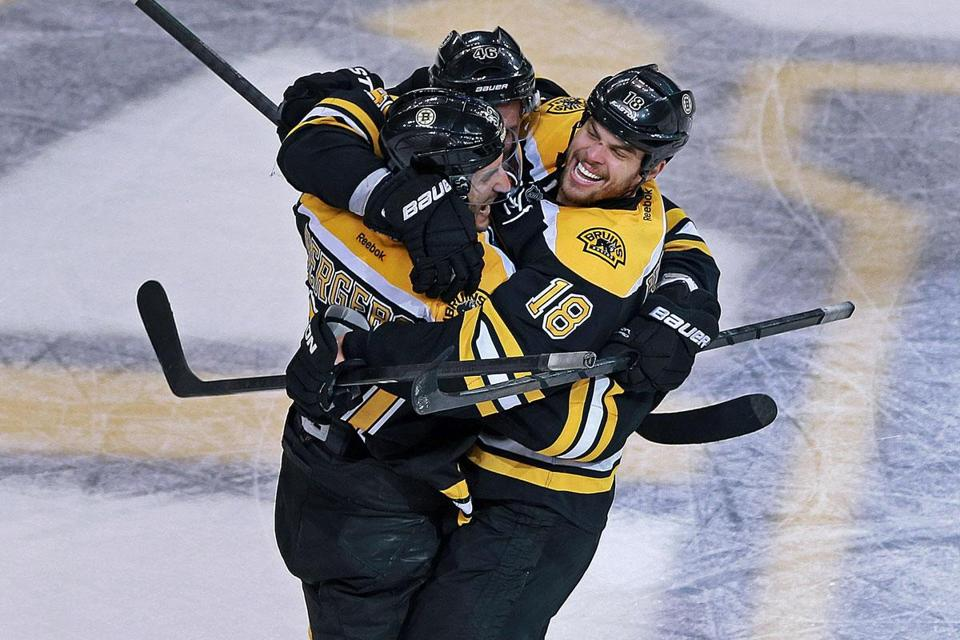 Patrice Bergeron tied it at 4-4, then celebrated with Nathan Horton (18) and David Krejci.
