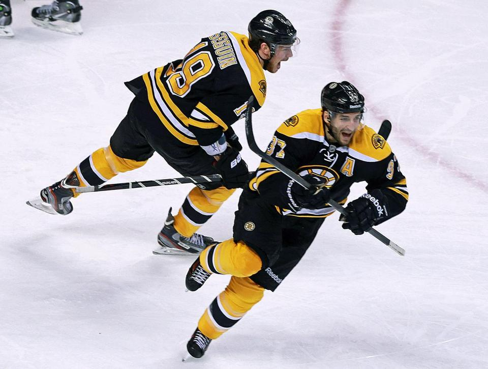 Patrice Bergeron, right, and Tyler Seguin celebrated after Bergeron's game-winning goal in overtime.