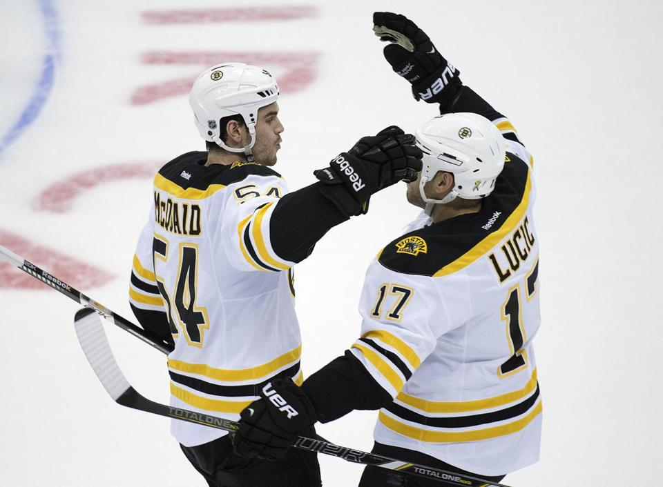 Adam McQuaid (left) and Milan Lucic celebrate a goal in Game 3 against the Maple Leafs. (AP Photo/Canadian Press, Nathan Denette)