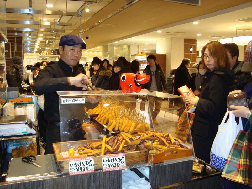 A vendor and his wares in the food court of a Tokyo department store.