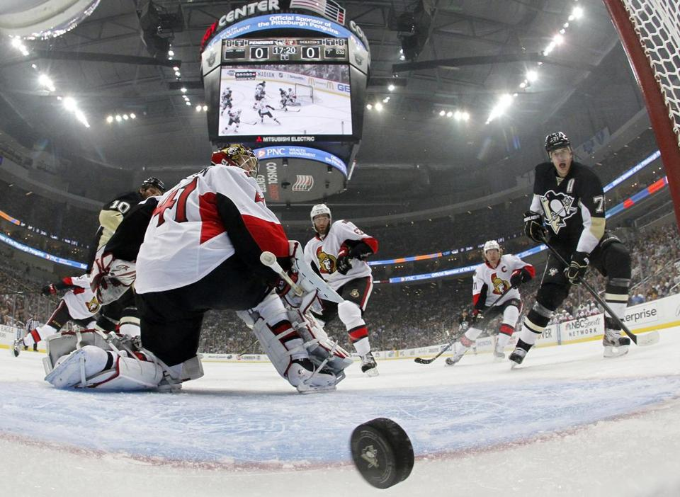 Senators goalie Craig Anderson is beaten by the Penguins' Paul Martin (7) on the power play early in Game 1.