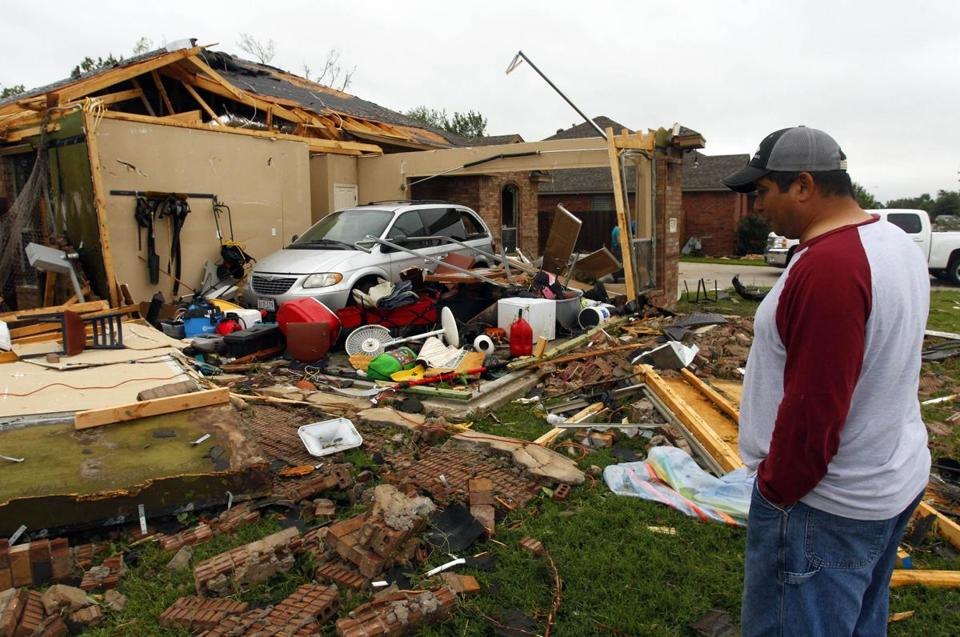 Pete Alaniz assessed the damage to the garage of his home that was destroyed by a tornado in Cleburne, Texas.