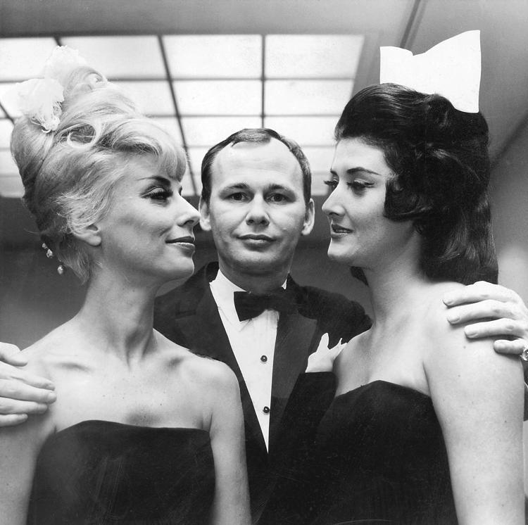 Kenneth Battelle (with models) gave Jackie Kennedy her iconic hairdo.