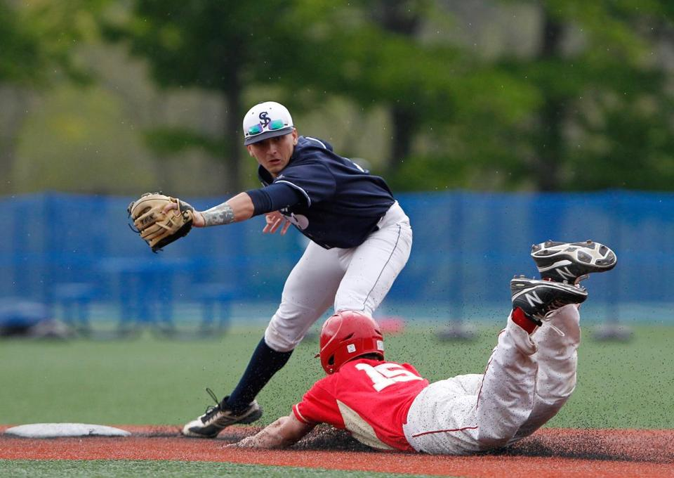 Everett's Matt Pothier (right) is tagged out by St. John's Prep second baseman Tommy Buonopane in Danvers Wednesday.