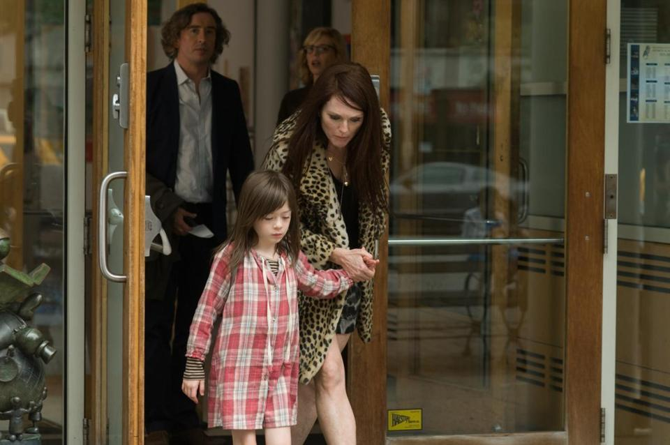 "Maisie (Onata Aprile) and her mother, Susanna (Julianne Moore), in ""What Maisie Knew."""