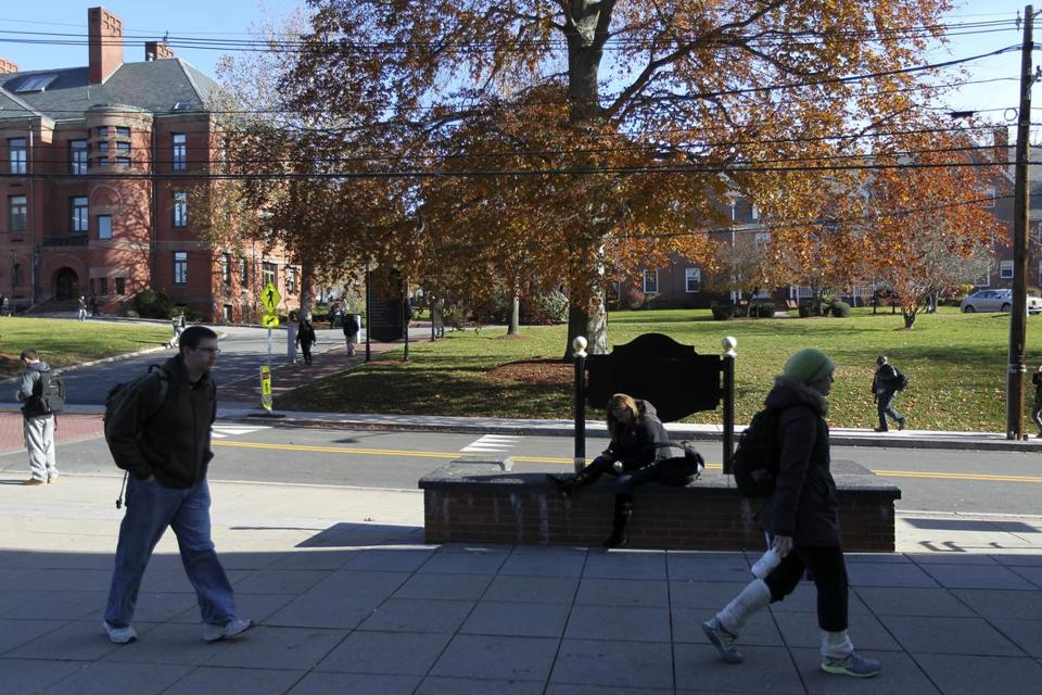 Students and other pedestrians on the campus of Framingham State University, which is adjacent to Route 9.