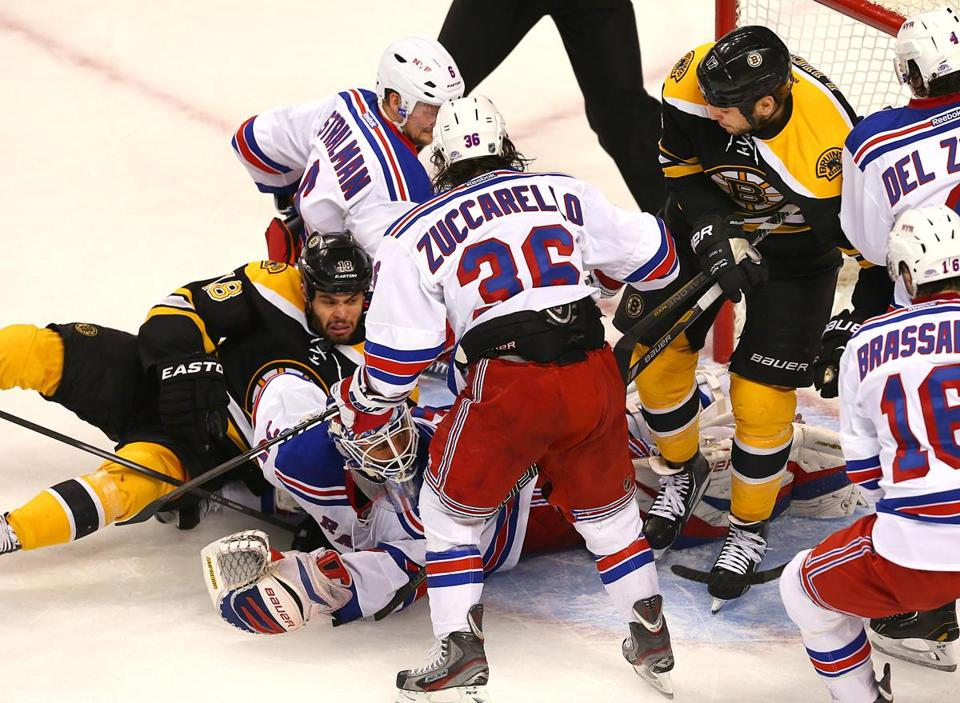 Rangers goaltender Henrik Lundqvist went flat-out for this stop amid the crowd in the first, one of his 45 in Game 1.