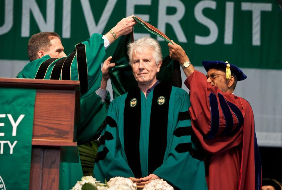 Boston, MA -- 05/18/13 -- Honorary degree recipient Graham Nash receives his honors at the Lesley University Commencement ceremony on May 18, 2013 at the Bank of America Pavilion in Boston, Massachusetts. (Kayana Szymczak for the Boston Globe)
