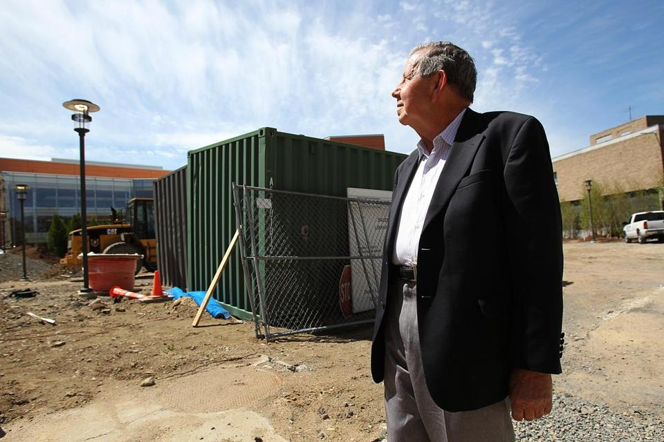 Eric Kahn, a Holocaust survivor from Swampscott, visits the construction site of Salem State University's new genocide studies center.
