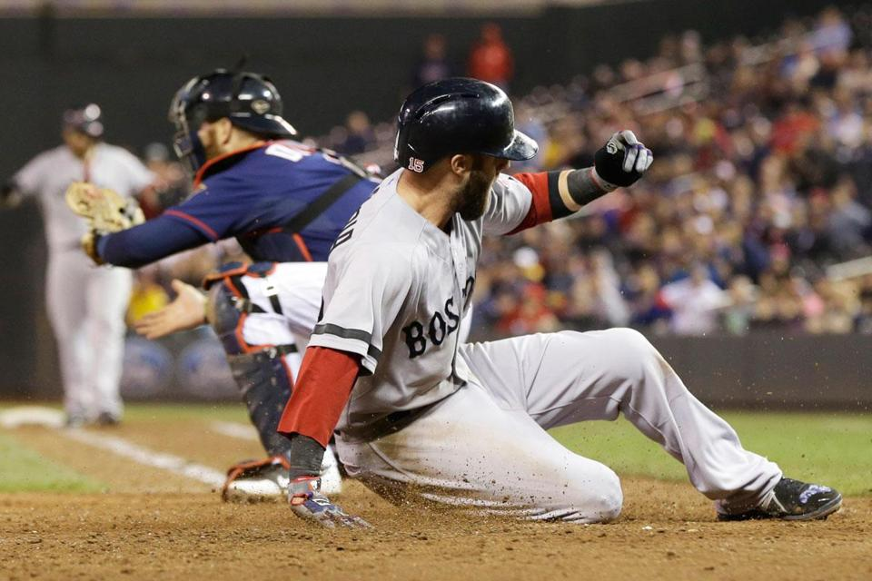 Dustin Pedroia scores ahead of the throw to the plate in the 10th inning, coming home on Jonny Gomes's sacrifice fly.