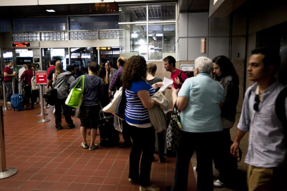 Passengers at Boston's South Station lined up on Monday to board a bus bound for New York City run by Greyhound.