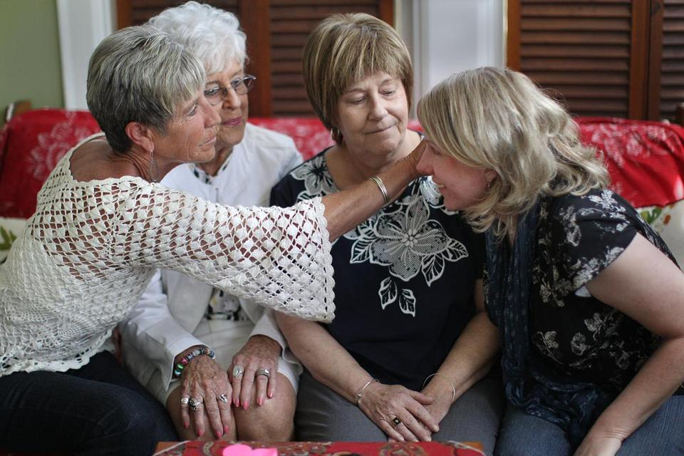 From left: Lisa Whalen, Joan Eppich, Mary Ellen Dean, and Lesley Keays at Keays's home in North Attleborough. The four relatives have all taken steps to reduce their cancer risk in recent months.