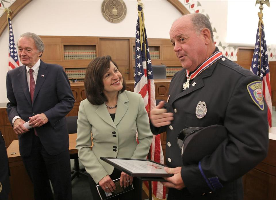 US Attorney Carmen Ortiz congratulated Mark Gibbons on Monday after he received the Congressional Badge of Bravery, the highest honor a law enforcement officer can earn.