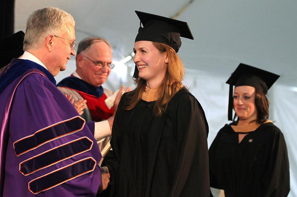 Marathon bombing victims Brittany Loring (left) and Liza Cherney received their diplomas during the BC commencement.