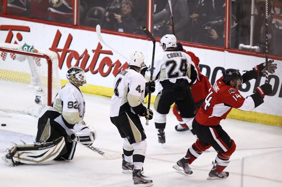 Ottawa's Colin Greening heads off to celebrate after beating Tomas Vokoun (left) in the second OT of Game 3.