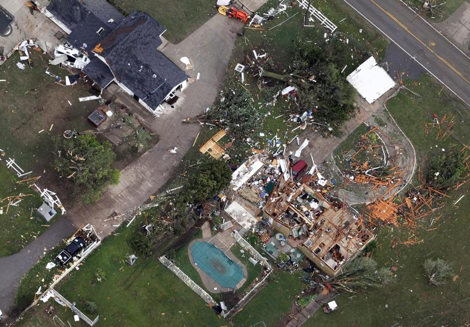 An aerial view showed homes damaged by Monday's tornado in Moore, Okla.