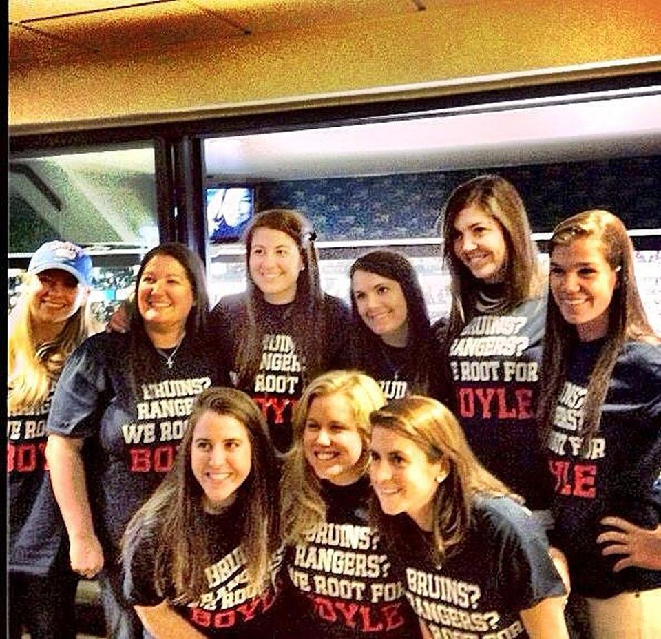 "Friends and family wear the special ""Bruins? Rangers? We're rooting for Boyle"" T-shirts."