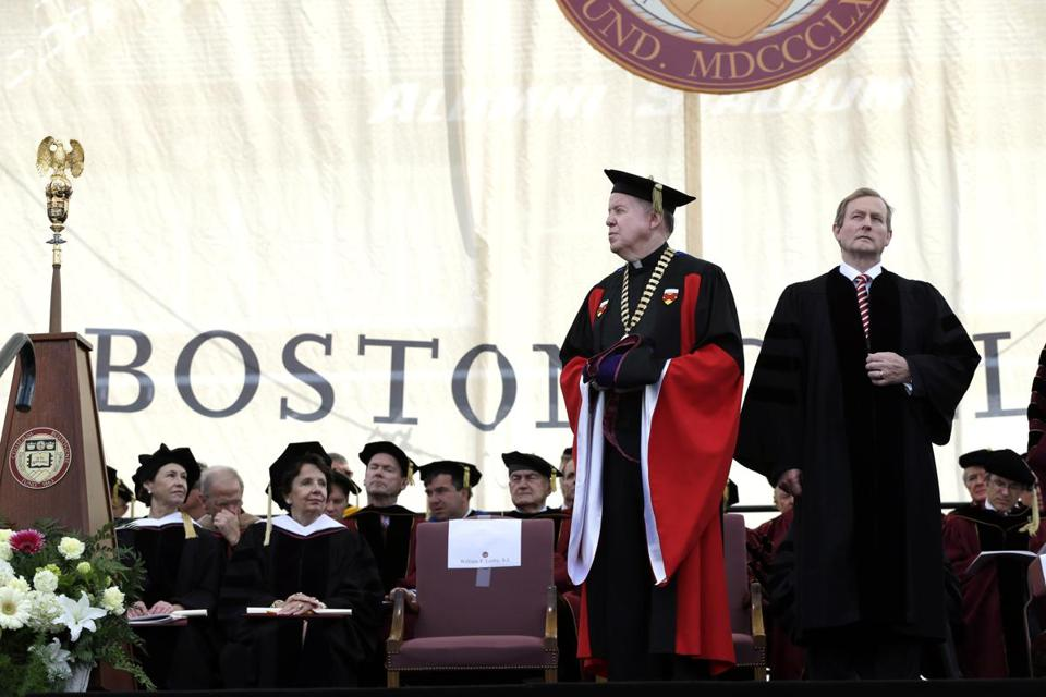 Irish Prime Minister Enda Kenny (right) stood to receive an honorary degree from Boston College president William P. Leahy during commencement ceremonies Monday.