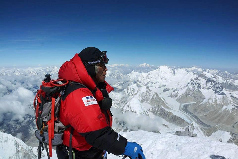 ''This is the world's best feeling, although I'm totally exhausted,'' Yuichiro Miura said from Everest's summit.