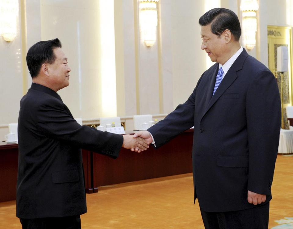 In Beijing, President Xi Jinping of China (right) greeted Vice Marshal Choe Ryong Hae of North Korea.