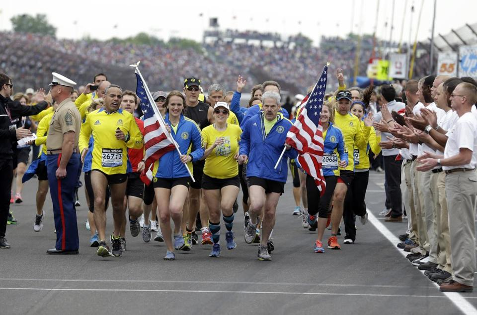 A group of the approximately 35 runners from the 2013 Boston Marathon, unable to finish the race due to the bombings, completed the distance by crossing finish line at the Indianapolis Motor Speedway.