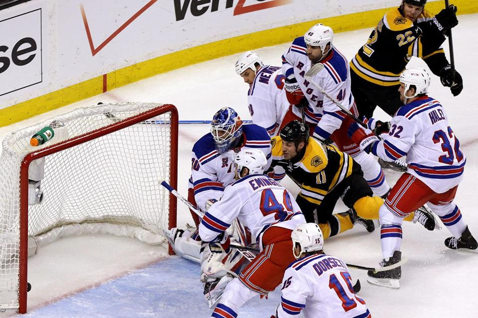 Gregory Campbell (11) lifted the puck past Rangers goaltender Henrik Lundqvist to give the Bruins a 2-1 lead in the second period of Game 5.