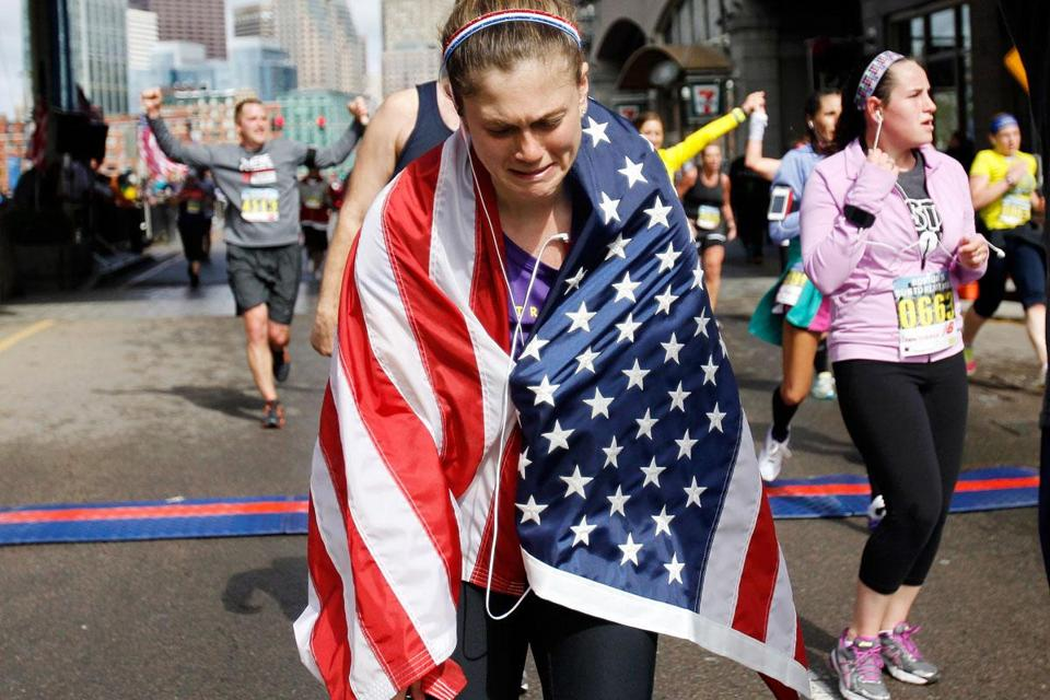 An emotional Samantha Herwig of Salem crosses the finish line of the ninth Run to Remember on Sunday.