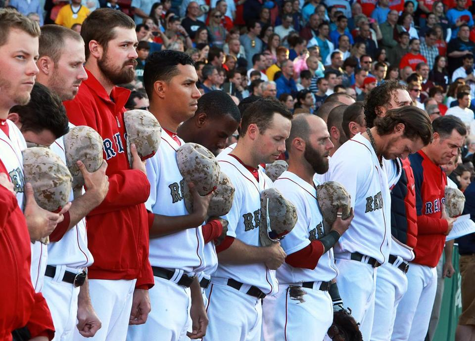 The Red Sox and Phillies paid tribute to veterans on Memorial Day, wearing uniforms and caps that featured US Marine Corps military camouflage.