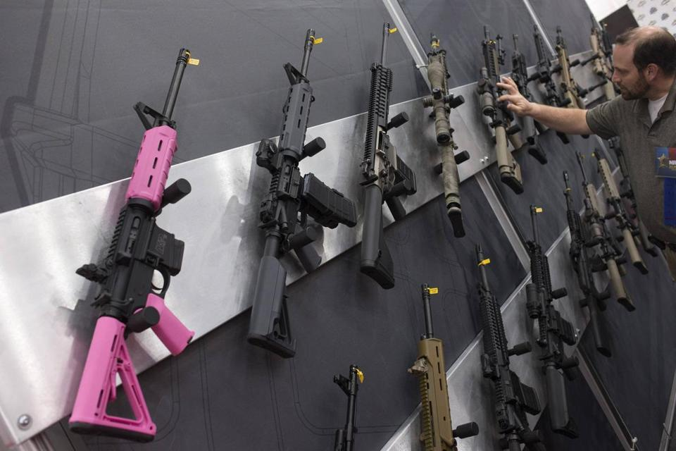 Assault rifles hangs at an exhibit booth at the National Rifle Association's annual meeting in Houston, Texas, on May 5.
