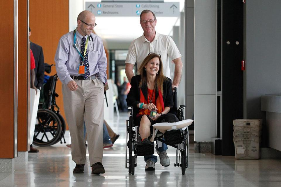 Beth Roche laughed with Dr. David Crandell and her husband, Ken, at Spaulding Rehabilitation Hospital in Charlestown.