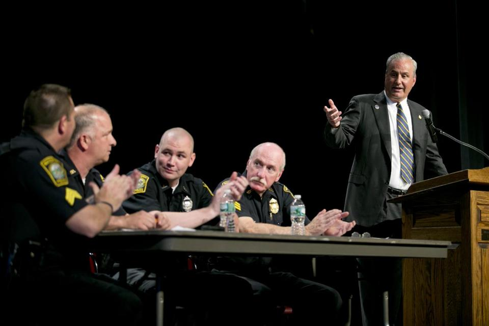Police Chief Edward Deveau (right) spoke at a community forum Wednesday, where he assured residents that their questions would be answered after the investigation is over.
