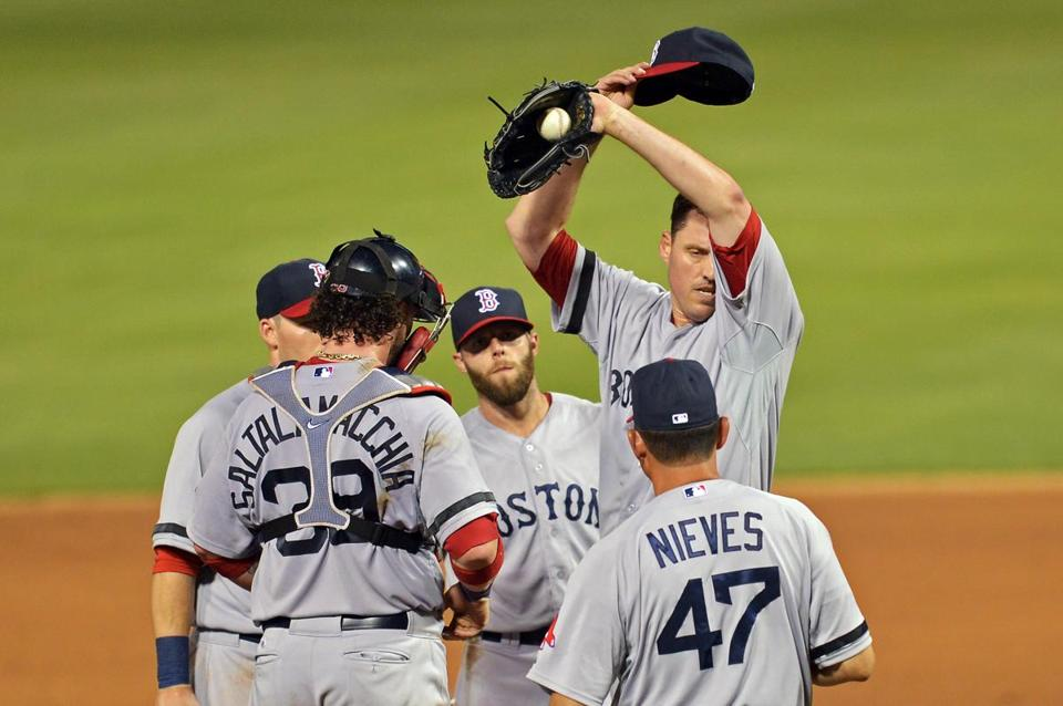 John Lacker, center, and the Red Sox fell for the second straight night on Wednesday.