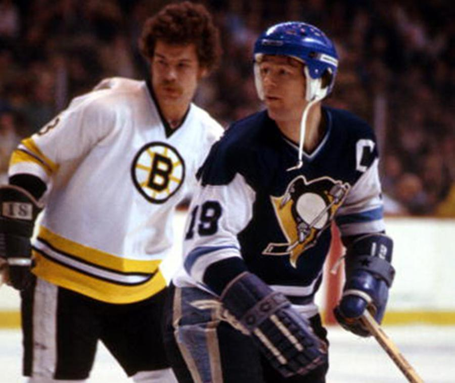 Jean Pronovost (with John Wensink nearby) sports the early Penguins attire.