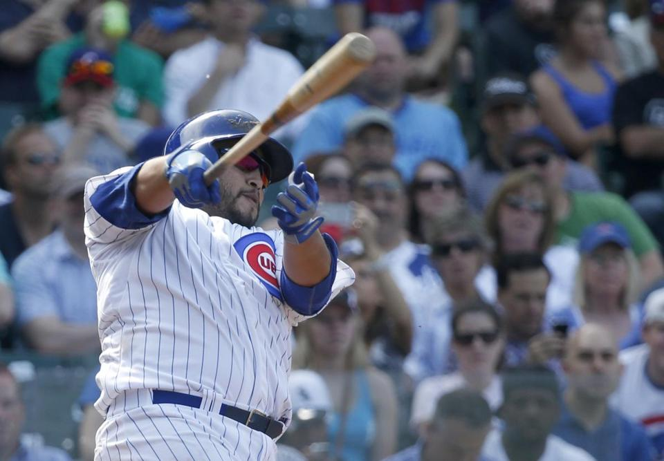 Dioner Navarro of the Cubs hits a three-run home run in the seventh inning, giving him three homers and six RBIs on the day.