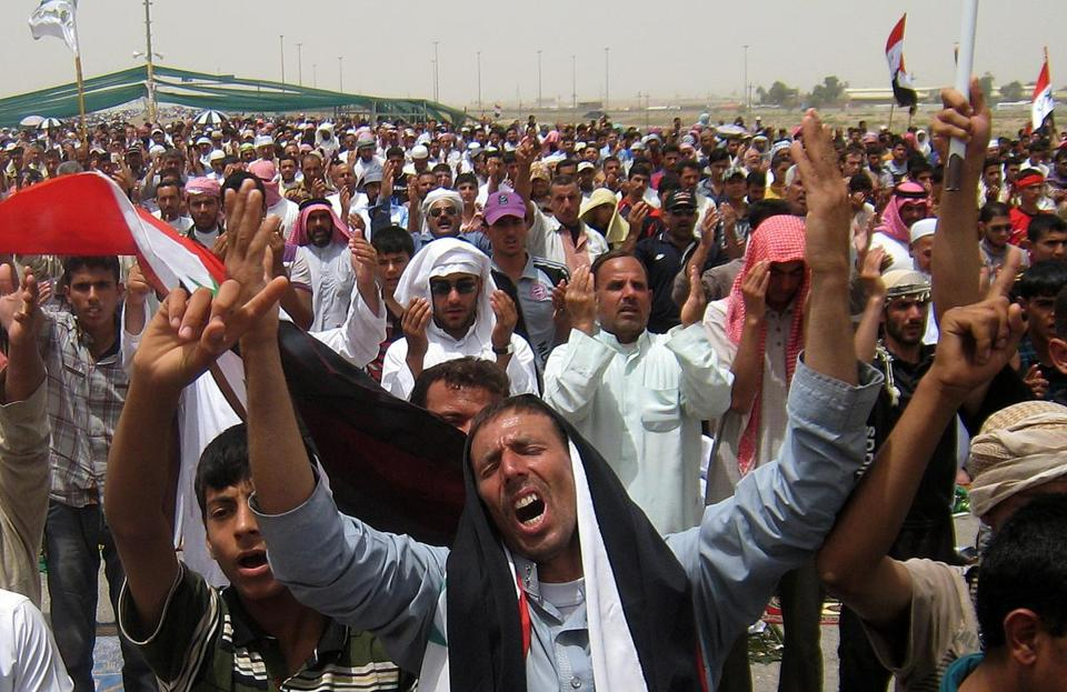 Iraqis chanted antigovernment slogans Friday at a protest in Fallujah, where three police officers died in an attack.